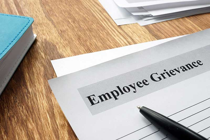 Employee Grievance form on an office desk.