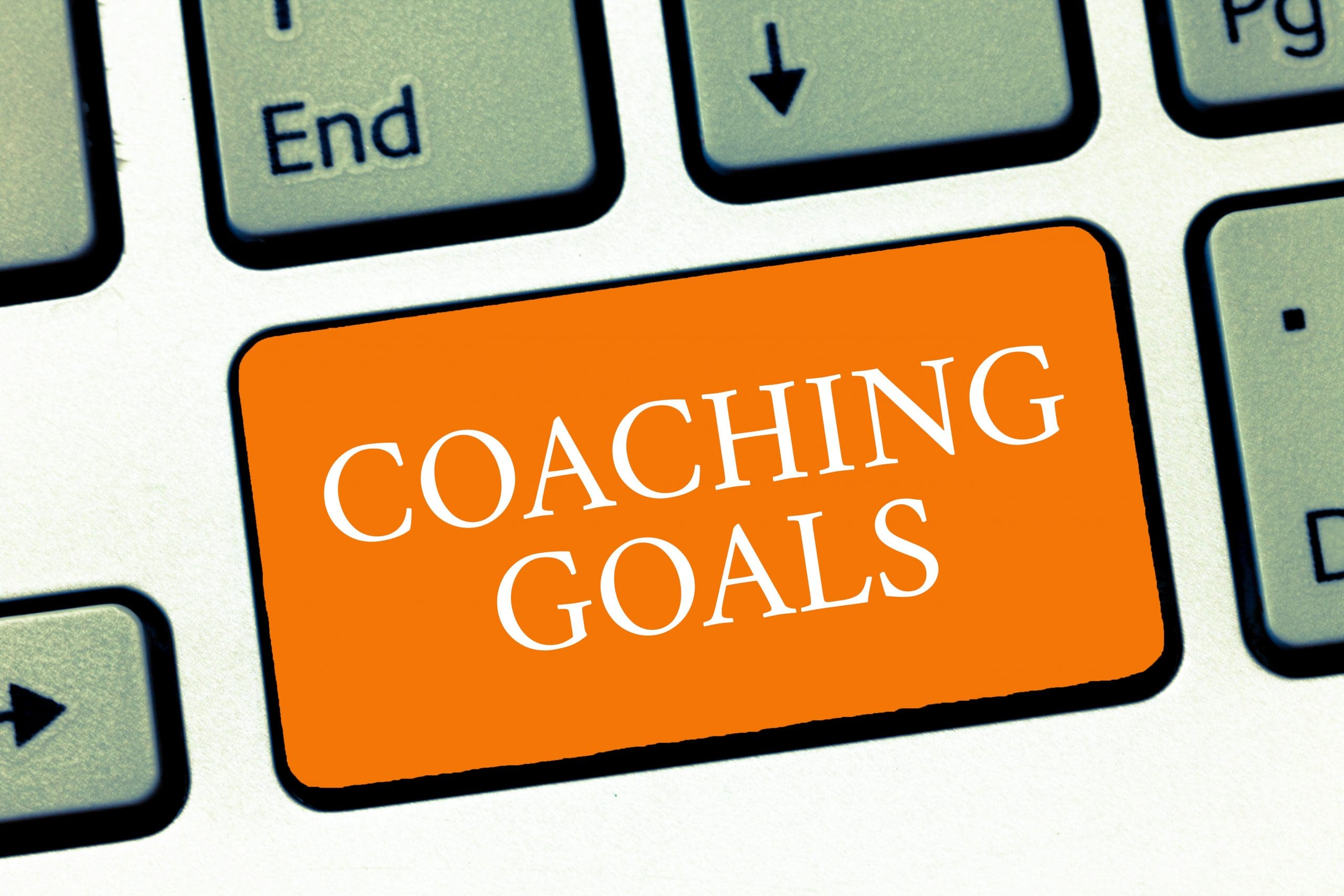 Illustrated keyboard with a key entitled, 'Coaching goals'.